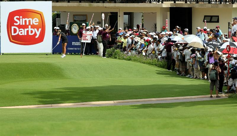 KUALA LUMPUR, MALAYSIA - OCTOBER 24 : Natalie Gulbis of USA hits her tee shot on the 1st hole during the Final Round of the Sime Darby LPGA on October 24, 2010 at the Kuala Lumpur Golf and Country Club in Kuala Lumpur, Malaysia. (Photo by Stanley Chou/Getty Images)