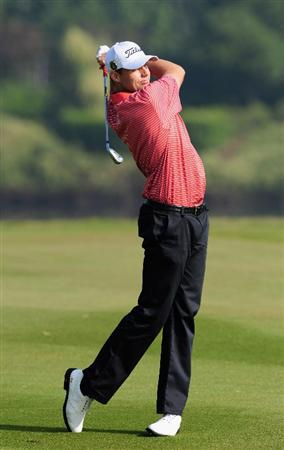 SHENZHEN, GUANGDONG - NOVEMBER 25: Nick Watney of USA plays a shot during the pro - am at the Omega Mission Hills World Cup on the Olazabal course on November 25, 2009 in Shenzhen, China. (Photo by Stuart Franklin/Getty Images)