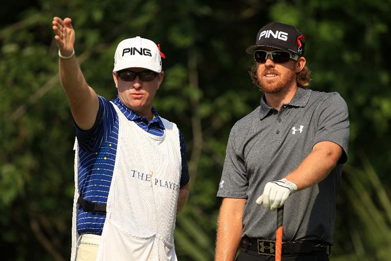 PONTE VEDRA BEACH, FL - MAY 13:  Hunter Mahan (R) talks with his caddie Ron Levin (L) on the fifth hole during the second round of THE PLAYERS Championship held at THE PLAYERS Stadium course at TPC Sawgrass on May 13, 2011 in Ponte Vedra Beach, Florida.  (Photo by Streeter Lecka/Getty Images)