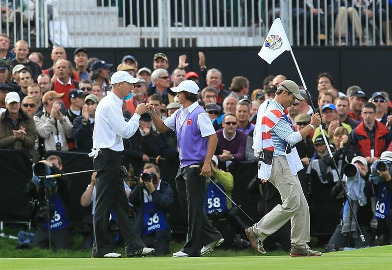 NEWPORT, WALES - OCTOBER 02:  Rickie Fowler (R) of the USA is congratulated by Jim Furyk on the 18th green after they halved their match during the rescheduled Afternoon Foursome Matches during the 2010 Ryder Cup at the Celtic Manor Resort on October 2, 2010 in Newport, Wales.  (Photo by David Cannon/Getty Images)