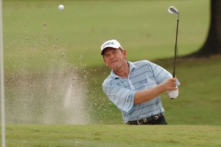Nick Price blasts from a bunker in front of the 13th green  during the third  round of  the 2005 Funai Classic at World Disney World Resort October 22.Photo by Al Messerschmidt/WireImage.com