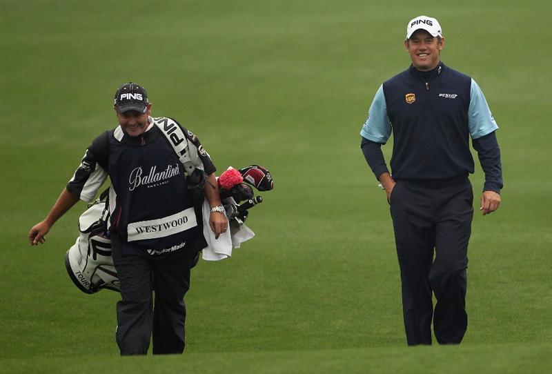 ICHEON, SOUTH KOREA - APRIL 30:  Lee Westwood of England (right) shares a joke with his caddie Billy Foster on the first hole during the third round of the Ballantine's Championship at Blackstone Golf Club on April 30, 2011 in Icheon, South Korea.  (Photo by Andrew Redington/Getty Images)