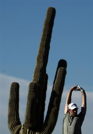 MARANA, AZ - FEBRUARY 25:  Oliver Wilson of England stretches on the fourth tee during the first round of the Accenture Match Play Championship at the Ritz-Carlton Golf Club at Dove Mountain on February 25, 2009 in Marana, Arizona.  (Photo by Donald Miralle/Getty Images)