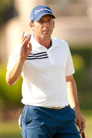 IRVING, TX - MAY 27: Sergio Garcia of Spain raises his ball to acknowledge the gallery during the second round of the HP Byron Nelson Championship at TPC Four Seasons at Las Colinas on May 27, 2011 in Irving, Texas. (Photo by Darren Carroll/Getty Images)