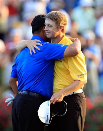 PONTE VEDRA BEACH, FL - MAY 15:  (L-R) K.J. Choi of South Korea hugs David Toms after defeating him on the first playoff hole to win THE PLAYERS Championship held at THE PLAYERS Stadium course at TPC Sawgrass on May 15, 2011 in Ponte Vedra Beach, Florida.  (Photo by Sam Greenwood/Getty Images)