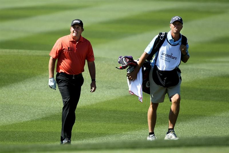 MARANA, AZ - FEBRUARY 24:  Phil Mickelson smiles as he walks up the fairway with caddie Jim 'Bones' Mackay (R) on the 13th hole during the second round of the Accenture Match Play Championship at the Ritz-Carlton Golf Club on February 24, 2011 in Marana, Arizona.  (Photo by Andy Lyons/Getty Images)