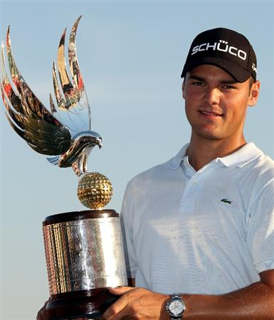 ABU DHABI, UNITED ARAB EMIRATES - JANUARY 24:  Martin Kaymer of Germany poses with the trophy after winning The Abu Dhabi Golf Championship at Abu Dhabi Golf Club on January 24, 2010 in Abu Dhabi, United Arab Emirates.  (Photo by Andrew Redington/Getty Images)