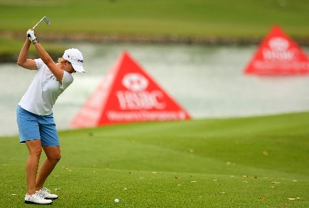 SINGAPORE - MARCH 02:  Karrie Webb of Australia hits her approach shot on the seventh hole during the final round of the HSBC Women's Champions at Tanah Merah Country Club March 2, 2008 in Singapore.  (Photo by Scott Halleran/Getty Images)