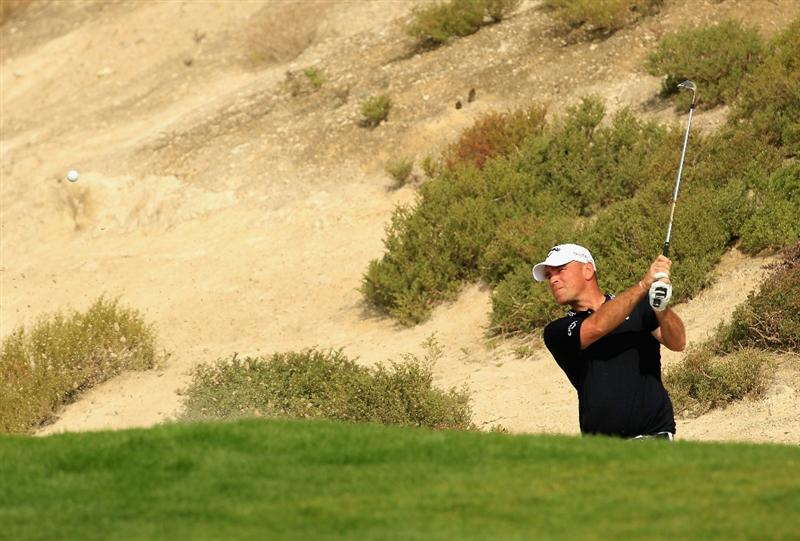 BAHRAIN, BAHRAIN - JANUARY 28:  Thomas Bjorn of Denmark in action during the second round of the Volvo Golf Champions at The Royal Golf Club on January 28, 2011 in Bahrain, Bahrain.  (Photo by Andrew Redington/Getty Images)