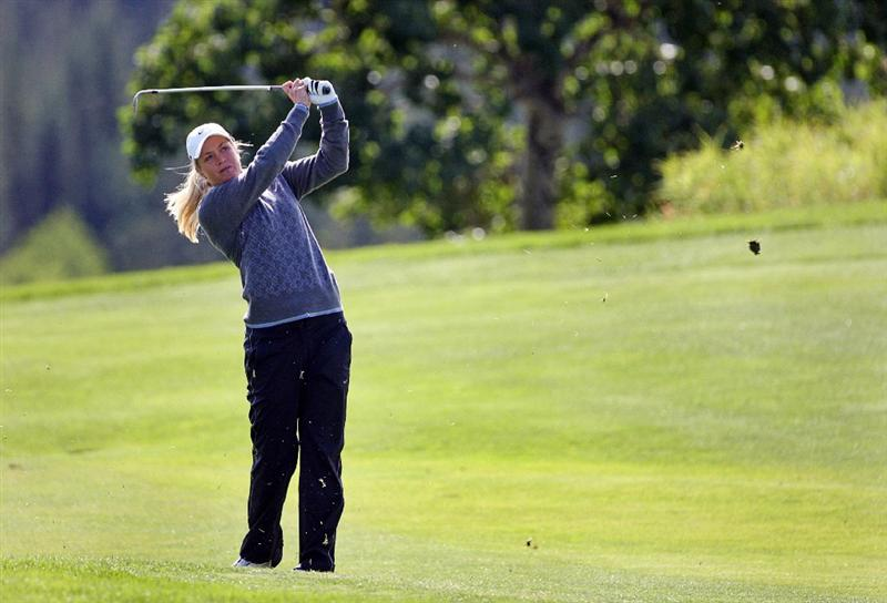 CALGARY, AB - SEPTEMBER 04 : Suzann Pettersen of Norway hits her third shot on the 18th hole during the second round of the Canadian Women's Open at Priddis Greens Golf & Country Club on September 4, 2009 in Calgary, Alberta, Canada. (Photo by Hunter Martin/Getty Images)