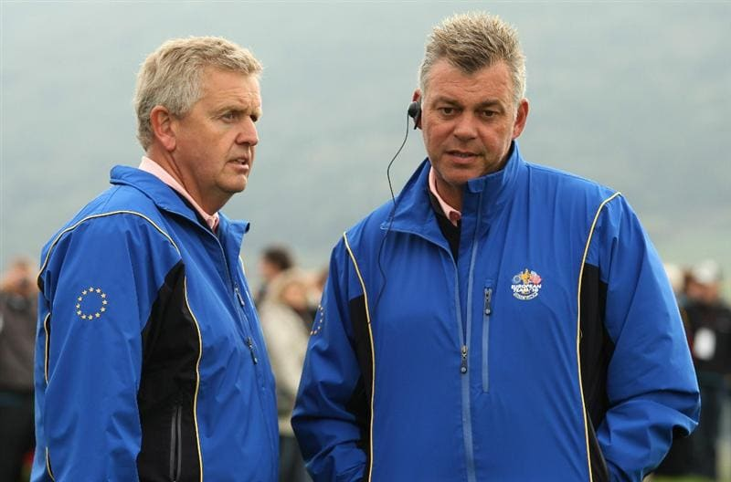 NEWPORT, WALES - SEPTEMBER 30:  Europe Team Captain Colin Montgomerie (L) chats with Vice Captain Darren Clarke during a practice round prior to the 2010 Ryder Cup at the Celtic Manor Resort on September 30, 2010 in Newport, Wales.  (Photo by Ross Kinnaird/Getty Images)