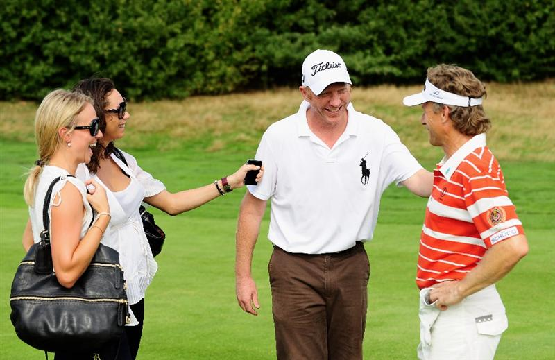 COLOGNE, GERMANY - SEPTEMBER 09:  German tennis legend Boris Becker introduces his wife Lilly Becker and her friend to German golfer Bernhard Langer during the pro - am prior to The Mercedes-Benz Championship at The Gut Larchenhof Golf Club on September 9, 2009 in Pulheim, near Cologne, Germany.  (Photo by Stuart Franklin/Getty Images)
