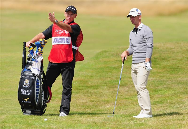 TURNBERRY, SCOTLAND - JULY 19:  Richard S Johnson of Sweden lines up a shot with caddy Mick Doran during the final round of the 138th Open Championship on the Ailsa Course, Turnberry Golf Club on July 19, 2009 in Turnberry, Scotland.  (Photo by Stuart Franklin/Getty Images)