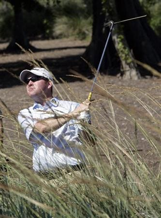 AVONDALE, LA - APRIL 25: Troy Matteson hits from the tall grass on the 15th hole during the third round of the Zurich Classic at TPC Louisiana on April 25, 2009  in Avondale, Louisiana. (Photo by Dave Martin/Getty Images)