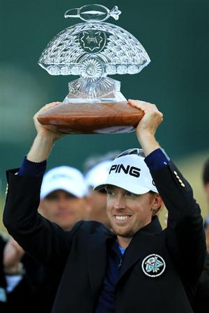 SCOTTSDALE, AZ - FEBRUARY 28:  Hunter Mahan holds aloft the trophy after winning the Waste Management Phoenix Open at TPC Scottsdale on February 28, 2010 in Scottsdale, Arizona.  (Photo by Chris McGrath/Getty Images)