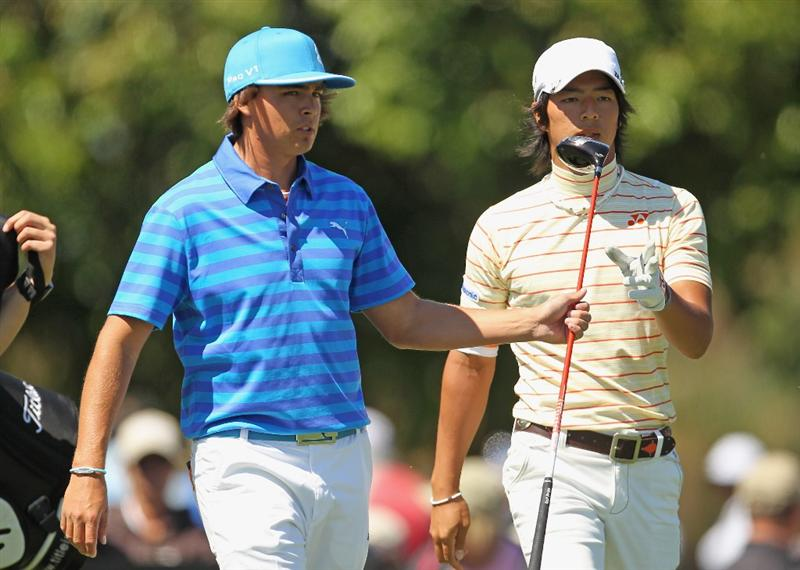 MIAMI, FL - MARCH 11:  Rickie Fowler (L) and Ryo Ishikawa of Japan walk off  the 17th tee during the second round of the 2011 WGC- Cadillac Championship at the TPC Blue Monster at the Doral Golf Resort and Spa on March 11, 2011 in Doral, Florida.  (Photo by Mike Ehrmann/Getty Images)