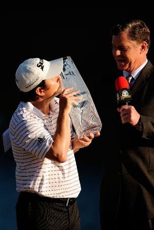 PONTE VEDRA BEACH, FL - MAY 09:  Tim Clark of South Africa celebrates with the trophy as Dan Patrick of NBC looks on during the trophy presentation after the final round of THE PLAYERS Championship held at THE PLAYERS Stadium course at TPC Sawgrass on May 9, 2010 in Ponte Vedra Beach, Florida.  (Photo by Sam Greenwood/Getty Images)