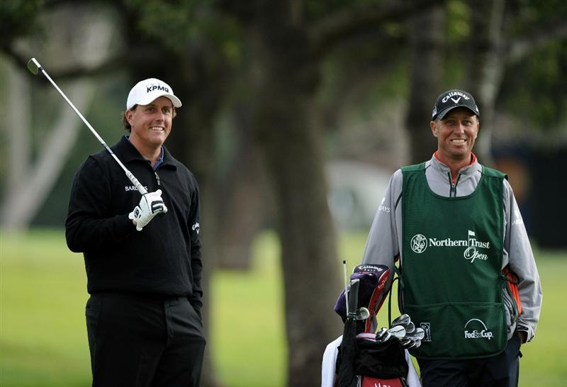 PACIFIC PALISADES, CA - FEBRUARY 18:  Phil Mickelson with caddie Jim MacKay on the second hole during the second round of the Northern Trust Open at the Riviera Country Club on February 18, 2011 in Pacific Palisades, California.  (Photo by Harry How/Getty Images)