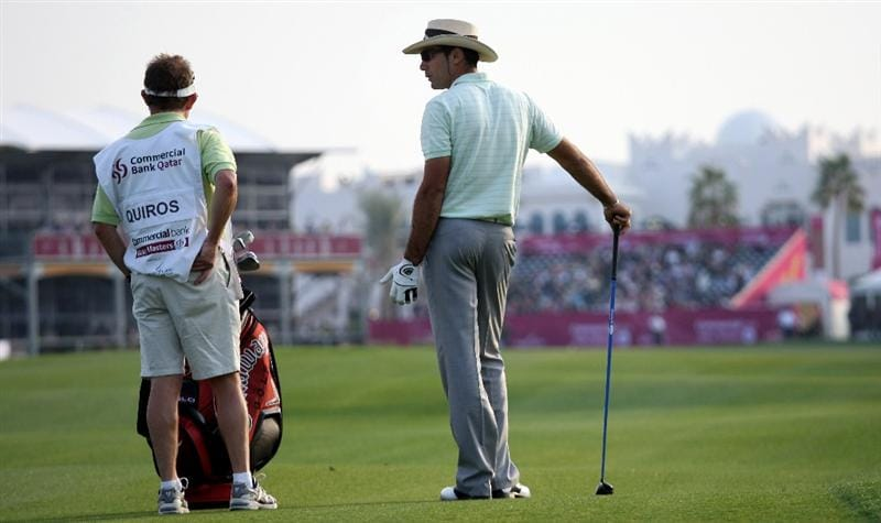 DOHA, QATAR - JANUARY 24:  Alvaro Quiros of Spain prepares to play his second shot on the par five 18th hole during the third round of the Commercialbank Qatar Masters at the Doha Golf Club on January 24,2009 in Doha, Qatar.  (Photo by Ross Kinnaird/Getty Images)
