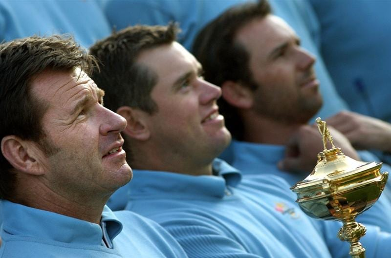 LOUISVILLE, KY - SEPTEMBER 16:  European team captain Nick Faldo (L) holds the trophy next to Lee Westwood (C) and Sergio Garcia (R) during the European Team photo shoot prior to the start of the 2008 Ryder Cup at Valhalla Golf Club of September 16, 2008 in Louisville, Kentucky.  (Photo by Ross Kinnaird/Getty Images)