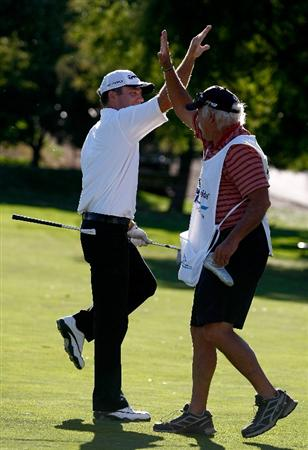 BOISE, ID - SEPTEMBER 20:  Fran Quinn high fives his caddie after hitting his second shot on the 18th hole to four feet setting up a winning birdie putt during the final round of the Albertson's Boise Open at Hillcrest Country Club on September 20, 2009 in Boise, Idaho.  (Photo by Jonathan Ferrey/Getty Images)