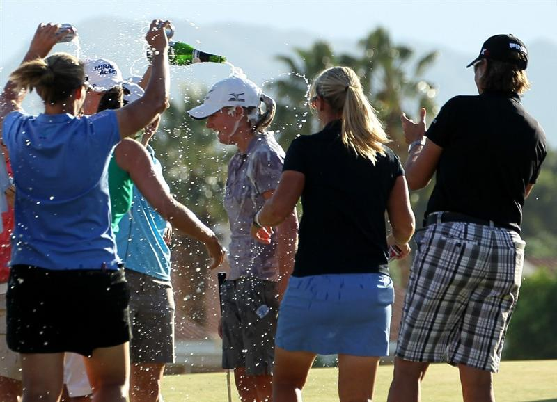 RANCHO MIRAGE, CA - APRIL 03:  Stacy Lewis (C) gets a champaign shower from fellow LPGA players after winning the Kraft Nabisco Championship during the final round at Mission Hills Country Club on April 3, 2011 in Rancho Mirage, California.  (Photo by Stephen Dunn/Getty Images)