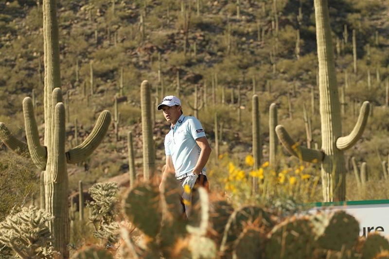 MARANA, AZ - FEBRUARY 18:  Nick Watney plays a shot on the 17th hole during round two of the Accenture Match Play Championship at the Ritz-Carlton Golf Club on February 18, 2010 in Marana, Arizona.  (Photo by Darren Carroll/Getty Images)