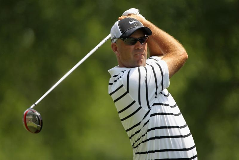 CHARLOTTE, NC - MAY 08:  Stewart Cink watches his tee his shot on the fourth hole during the final round of the Wells Fargo Championship at the Quail Hollow Club on May 8, 2011 in Charlotte, North Carolina.  (Photo by Scott Halleran/Getty Images)