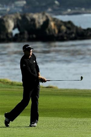 PEBBLE BEACH, CA - FEBRUARY 11:  Dustin Johnson hits his second shot on the 18th hole during the first round of the AT&T Pebble Beach National Pro-Am at Pebble Beach Golf Links on February 11, 2010 in Pebble Beach, California.  (Photo by Stephen Dunn/Getty Images)