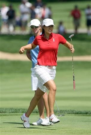 SUGAR GROVE, IL - AUGUST 23: Michelle Wie of the USA just misses an eagle putt at the 15th hole watched by her opponent Helen Alfredsson of Sweden during the Sunday singles matches at the 2009 Solheim Cup Matches, at the Rich Harvest Farms Golf Club on August 23, 2009 in Sugar Grove, Ilinois (Photo by David Cannon/Getty Images)