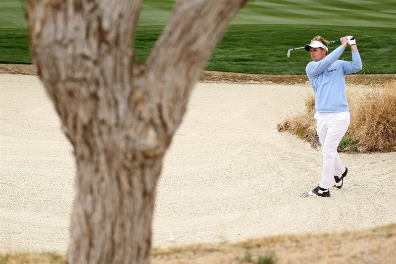 MARANA, AZ - FEBRUARY 26:  Luke Donald of England hits and approach shot from a bunker on the eighth hole during the semifinal round of the Accenture Match Play Championship at the Ritz-Carlton Golf Club on February 26, 2011 in Marana, Arizona.  (Photo by Andy Lyons/Getty Images)
