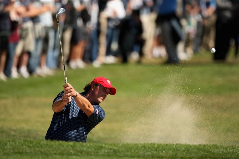SAN FRANCISCO - OCTOBER 09:  Phil Mickelson of the USA Team plays out of the 14th grrenside bunker during the Day Two Fourball Matches of The Presidents Cup at Harding Park Golf Course on October 9, 2009 in San Francisco, California.  (Photo by Warren Little/Getty Images)