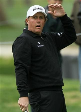 PACIFIC PALISADES, CA - FEBRUARY 18:  Phil Mickelson reacts as his chip shot on the 11th hole just misses going in during round two of the Northern Trust Open at Riviera Country Club on February 18, 2011 in Pacific Palisades, California.  (Photo by Stephen Dunn/Getty Images)