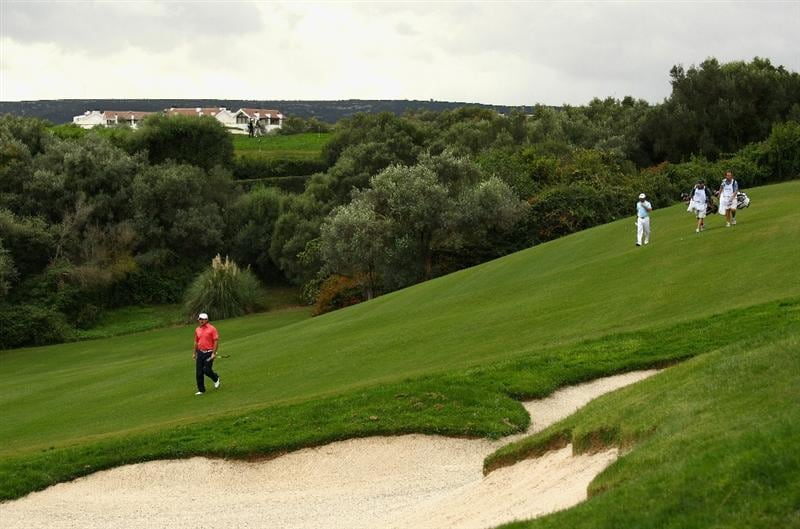 SOTOGRANDE, SPAIN - OCTOBER 30:  Graeme McDowell and Gareth Maybin of Northern Ireland walk to the 15th green with their caddies during the third round of the Andalucia Valderrama Masters at Club de Golf Valderrama on October 30, 2010 in Sotogrande, Spain.  (Photo by Richard Heathcote/Getty Images)
