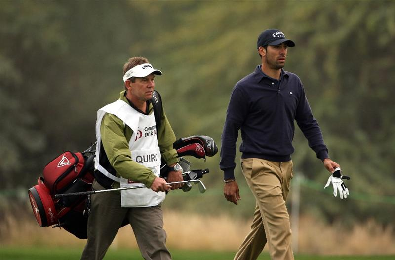 DOHA, QATAR - JANUARY 23:  Alvaro Quiros of Spain walks with his caddie Dave McNeilly on the tenth hole during the second round of  the Commercialbank Qatar Masters at Doha Golf Club on January 23, 2009 in Doha, Qatar.  (Photo by Andrew Redington/Getty Images)