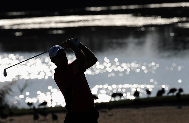 VILAMOURA, PORTUGAL - OCTOBER 17:  Padraig Harrington of Ireland plays his approach shot on the 14th hole during the third round of the Portugal Masters at the Oceanico Victoria Golf Course on October 17, 2009 in Vilamoura, Portugal.  (Photo by Stuart Franklin/Getty Images)