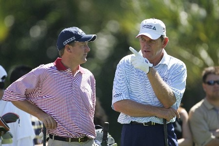 Mark Brooks chats with Nick Price on the 7th tee in the third round of the Ford Championship at Doral in Miami, Florida. March 5, 2005