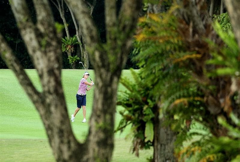 SINGAPORE - FEBRUARY 25:  Helen Alfredsson of Sweden hits her second shot on the 4th hole during the first round of the HSBC Women's Champions at Tanah Merah Country Club on February 25, 2010 in Singapore, Singapore.  (Photo by Andy Lyons/Getty Images)