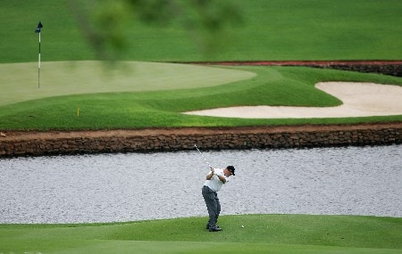 MALELANE, SOUTH AFRICA - DECEMBER 06:  John Bickerton of England plays his approach shot into the 18th green during the first round of The Alfred Dunhill Championship at The Leopard Creek Country Club on December 6, 2007 in Malelane, South Africa.  (Photo by Warren Little/Getty Images)