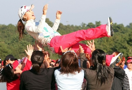 SHIMA, JAPAN - NOVEMBER 04:  Momoko Ueda of Japan is thrown into the air in celebration by LPGA player after winning the LPGA Mizuno Classic, at Kintetsu Kashikojima Country Club, on October 4, 2007, in Mie Prefecture, Japan. Mizuno Classic is the only LPGA Tour tournament taken place in Japan.  (Photo by Koichi Kamoshida/Getty Images)