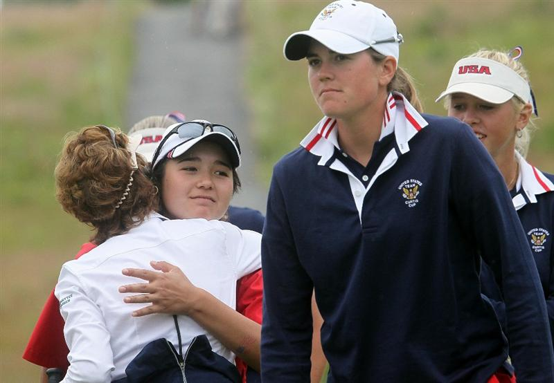 MANCHESTER, MA - JUNE 12:  Jennifer Song and teammates of the United States reacts after she sunk a putt on the 18th green a putt  in Four Ball competition during the second day of the 2010 Curtis Cup Match at the Essex Country Club on June 12, 2010 in Manchester, Massachusetts. (Photo by Jim Rogash/Getty Images)