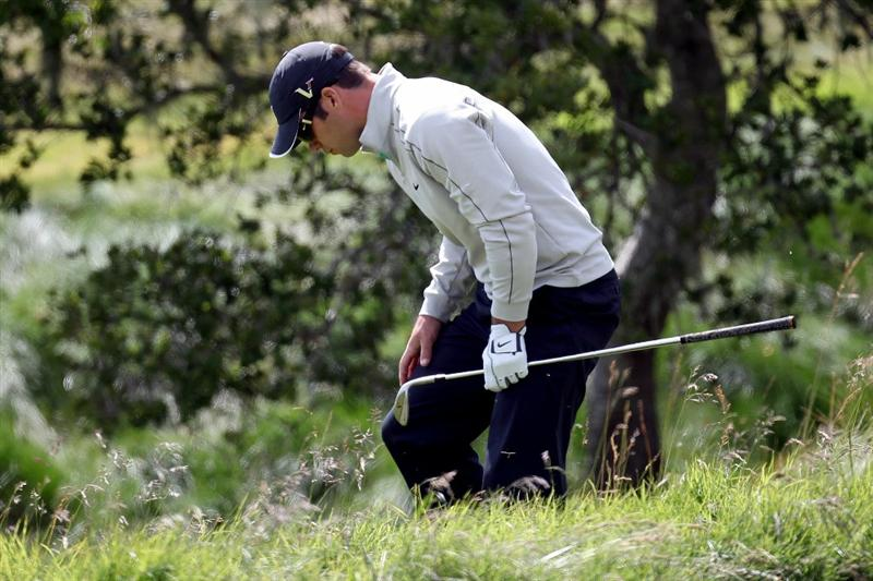 PEBBLE BEACH, CA - JUNE 19:  Paul Casey of England examines his lie in the rough on the second hole during the third round of the 110th U.S. Open at Pebble Beach Golf Links on June 19, 2010 in Pebble Beach, California.  (Photo by Ross Kinnaird/Getty Images)