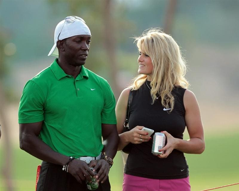 ABU DHABI, UNITED ARAB EMIRATES - JANUARY 22: Dwight Yorke of Trinidad and Tobago watching the golf with Carly Booth of Scotland during the third round of the 2011 Abu Dhabi HSBC Golf Championship held at the Abu Dhabi Golf Club on January 22, 2011 in Abu Dhabi, United Arab Emirates.  (Photo by David Cannon/Getty Images)