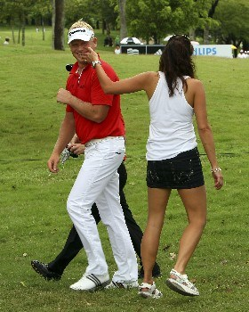 KUALA LUMPUR, MALAYSIA - MARCH 08:  Peter Hedblom of Sweden is congratulated by a female spectator after his par on the sixth hole during the third round of the Maybank Malaysian Open held at the Kota Permai Golf & Country Club on March 8, 2008 in Kuala Lumpur, Malaysia.  (Photo by Andrew Redington/Getty Images)