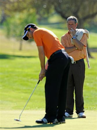 CASTELLON DE LA PLANA, SPAIN - OCTOBER 20:   Sergio Garcia of Spain is watched by father Victor Garcia as he putts during the pro - am prior to the start of the Castello Masters Costa Azahar at the Club de Campo del Mediterraneo on October 20, 2010 in Castellon de la Plana, Spain.  (Photo by Stuart Franklin/Getty Images)