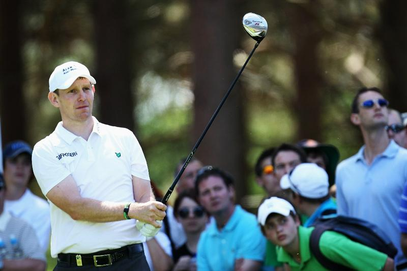 VIRGINIA WATER, ENGLAND - MAY 22:  Stephen Gallacher of Scotland plays his tee shot at the 11th hole during the third round of the BMW PGA Championship on the West Course at Wentworth on May 22, 2010 in Virginia Water, England.  (Photo by Ross Kinnaird/Getty Images)