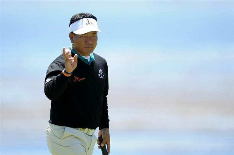 PEBBLE BEACH, CA - JUNE 17:   K.J. Choi of South Korea waves to the gallery on the 18th green during the first round of the 110th U.S. Open at Pebble Beach Golf Links on June 17, 2010 in Pebble Beach, California.  (Photo by Harry How/Getty Images)