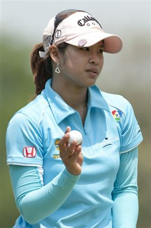 CHON BURI, THAILAND - FEBRUARY 19:  Pornanong Phatlum of Thailand acknowledges the crowd on the 1st green during day three of the LPGA Thailand at Siam Country Club on February 19, 2011 in Chon Buri, Thailand.  (Photo by Victor Fraile/Getty Images)