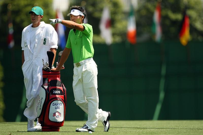 AUGUSTA, GA - APRIL 09: Amateur Danny Lee of New Zealand chats with his caddie Matt Fuzy on the first fairway during the first round of the 2009 Masters Tournament at Augusta National Golf Club on April 9, 2009 in Augusta, Georgia.  (Photo by Andrew Redington/Getty Images)