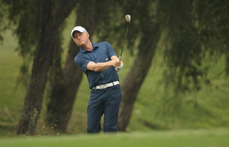 HONG KONG - NOVEMBER 18:  Simon Dyson of England looks on after playing a shot during day one of the UBS Hong Kong Open at The Hong Kong Golf Club on November 18, 2010 in Hong Kong, Hong Kong.  (Photo by Ian Walton/Getty Images)